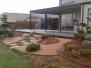 Omlægning af forhave og baghave med udsigt over golfbane
