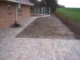 Omlægning af have med nye Herregårdssten og sti til sansehave og græsplæne