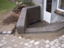 Støttemur med tilhørende trappe og belægning